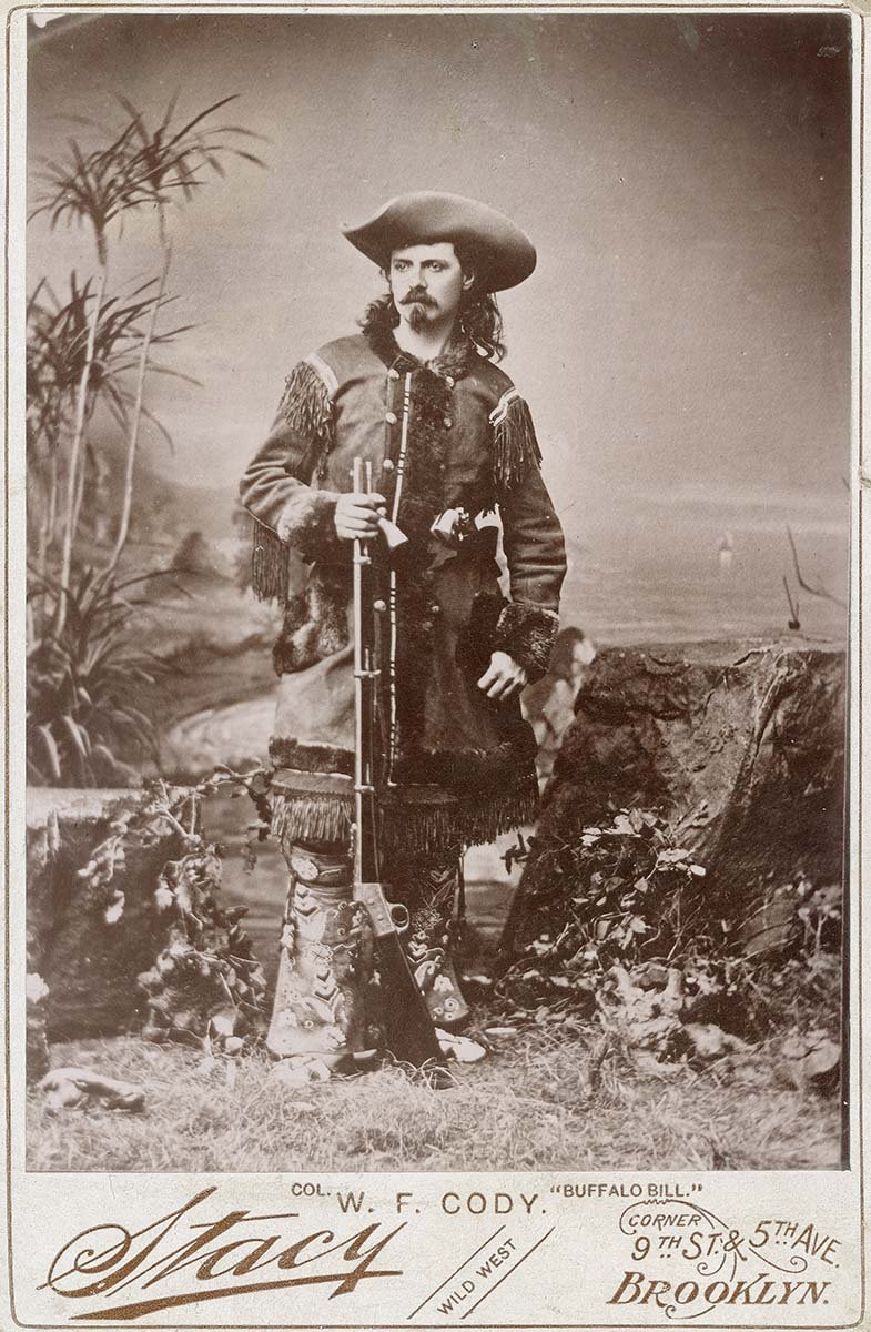 "hotograph, William F. ""Buffalo Bill"" Cody in fringed buckskin with rifle, ca. 1870-1880. Studio portrait by Stacy. Buffalo Bill Center of the West, Cody, Wyoming, USA. MS 6 William F. Cody Collection, McCracken Research Library. P.6.0156"