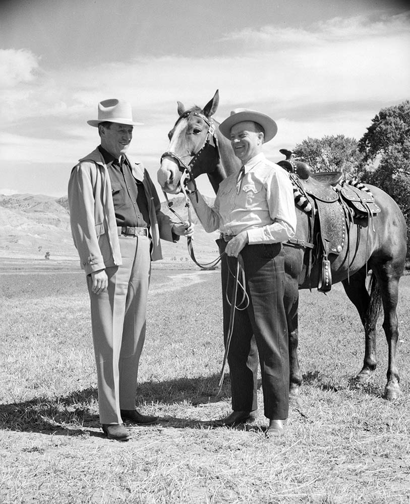 Robert W. Woodruff (left) and ventriloquist Edgar Bergen next to horse on TE Ranch, 1950. Jack Richard (1909-1992) photo. MS 089 Jack Richard Photograph Collection. PN.89.1.180.04