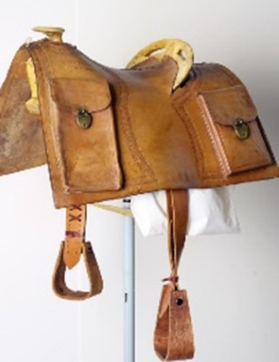 Pony Express style saddle with mochilla. Stamped left side front: PONY EXPRESS/MARCH 3RD 1860, Stamped left side back: LOUIS HOOK/S.L. CITY, Stamped right side front: JULY/24TH 1897, Stamped right side back: LOUIS HOOK/S.L. CITY. This is a reproduction possibly used in Wild West Show performances. Date: March 3, 1860; July 24, 1897 Credit: Museum purchase, Garlow Collection. 1.69.16