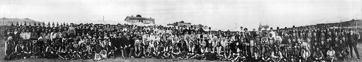 """Two Bills."" Buffalo Bill's Wild West and Pawnee Bill's Far East personnel, panoramic view, ca. 1912. Gift of Mrs. Bess Harwood, Billings, Montana. MS 6 William F. Cody Collection, McCracken Research Library. P.69.16"