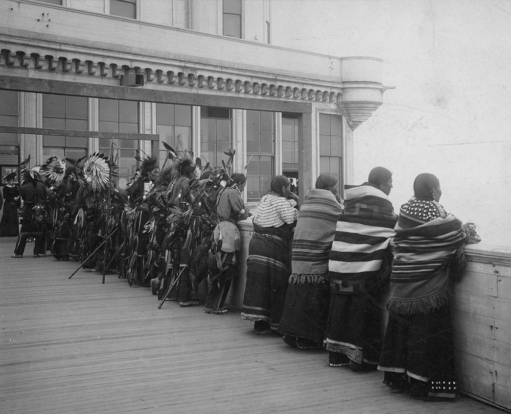 Wild West show Indians looking out from deck at Cliff House, San Francisco, California, 1902. MS 6 William F. Cody Collection, McCracken Research Library. P.69.784