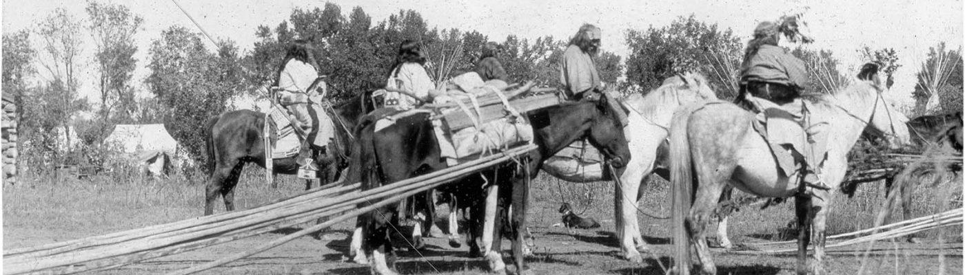 Crow riders dragging tipi poles, early 1900s. MS095 Petzoldt Collection, McCracken Research Library. LS.95.337