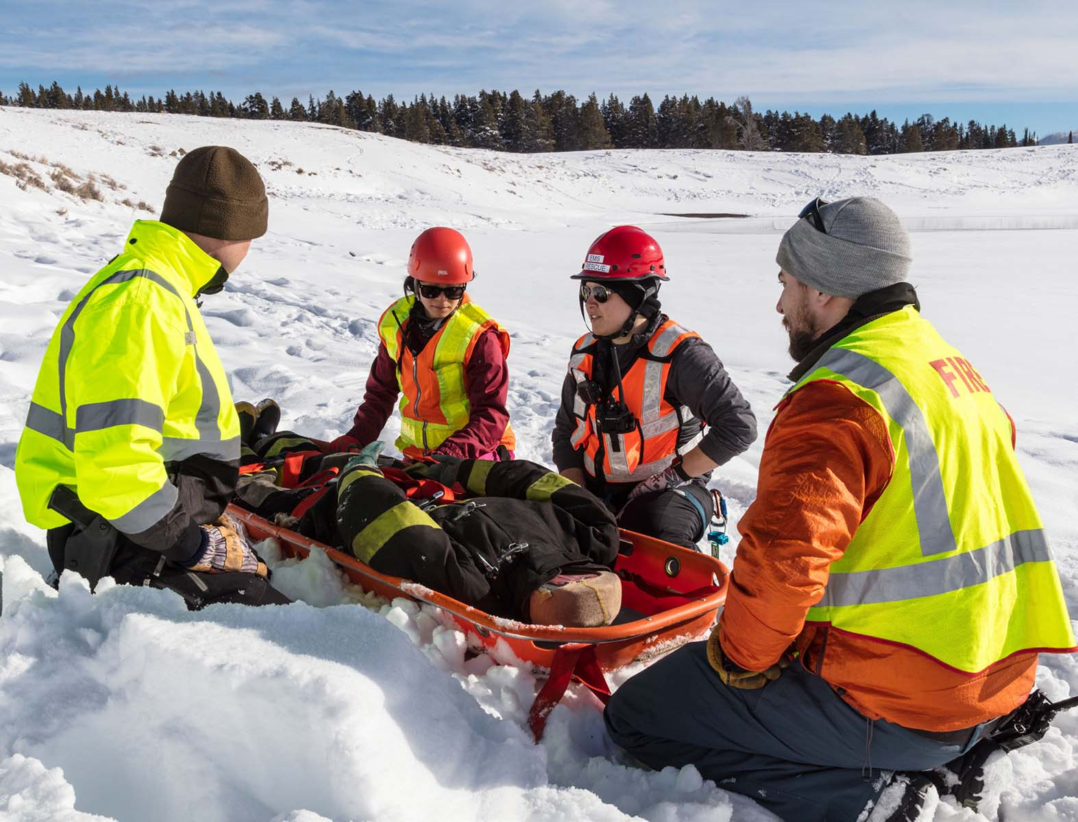 Search and Rescue volunteers in Yellowstone National Park train for a winter rescue operation. NPS photo/Jacob W. Frank.