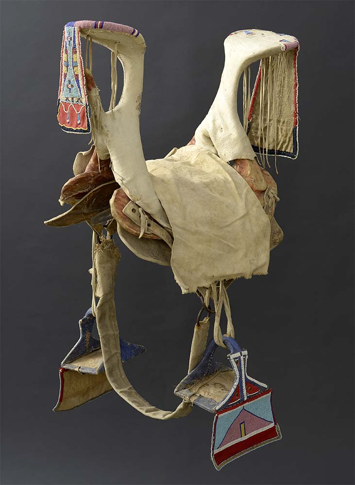 Crow saddle and stirrups, ca. 1900. Paul Dyck Plains Indian Buffalo Culture Collection, acquired through the generosity of the Dyck family and additional gifts of the Nielson Family and the Estate of Margaret S. Coe. NA.403.281