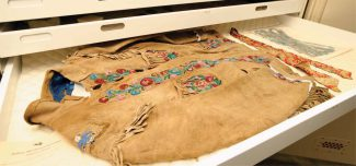 "A jacket owned by William F. ""Buffalo Bill"" Cody in the Buffalo Bill Museum vault. Made of buckskin with brass buttons, beads, and silk satin, ca. 1898. Gift of Robert Garland. 1.69.784"