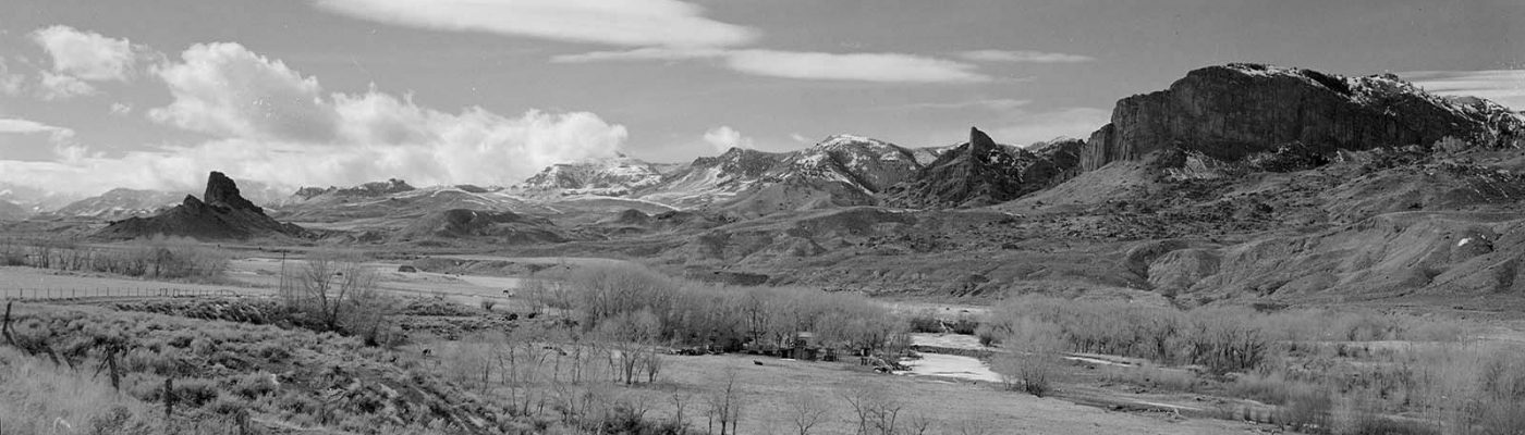 With the Absaroka Mountains in the background, Castle Rock stands in the South Fork Valley. The formation was originally named Ishawooa by the Shoshone Indians. From here, Jones and his party crossed the Absarokas to the North Fork of the Shoshone River on the other side. MS 089 Jack Richard Photograph Collection, McCracken Research Library. PN.89.114.21370.9