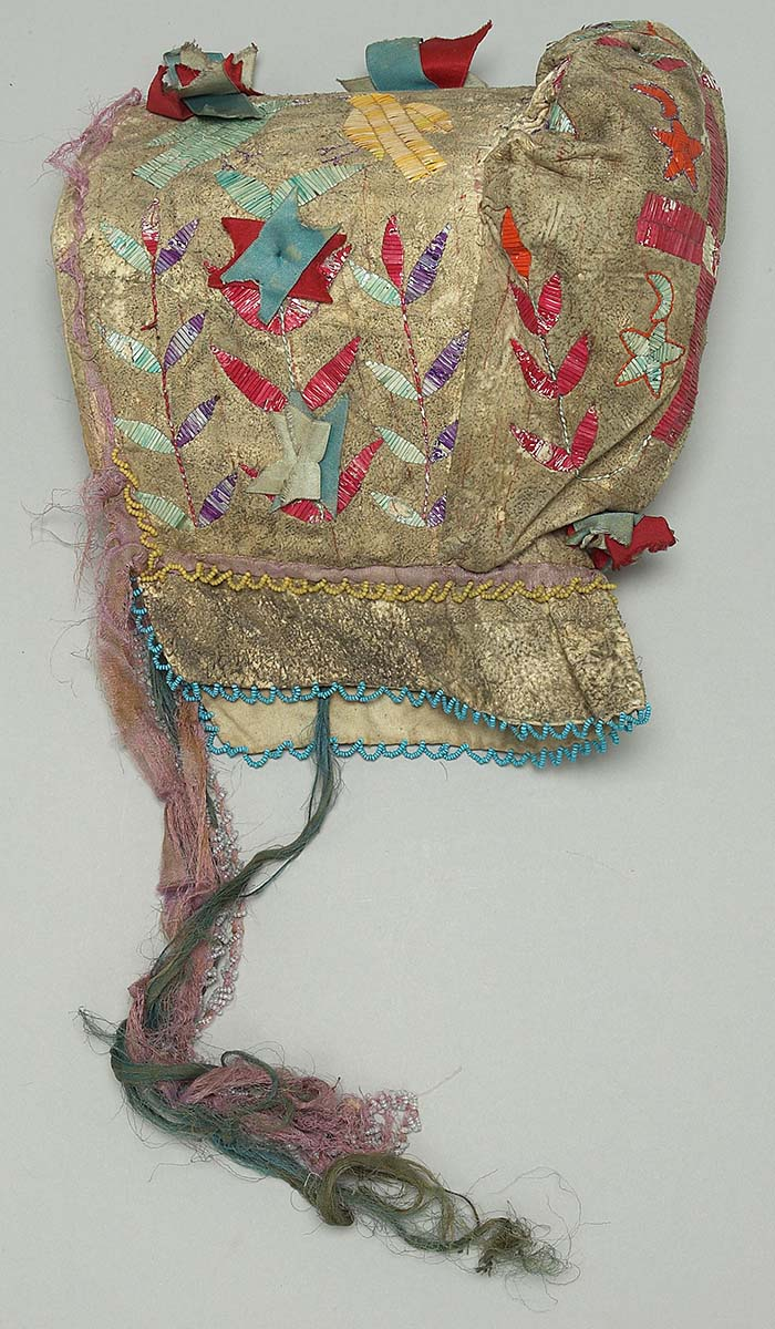 Sunbonnet, Dakota (Sioux), Northern Plains, ca. 1900. Tanned deer hide, dyed porcupine quills, glass beads, canvas, silk ribbons. Plains Indian Museum Collection. NA.202.94