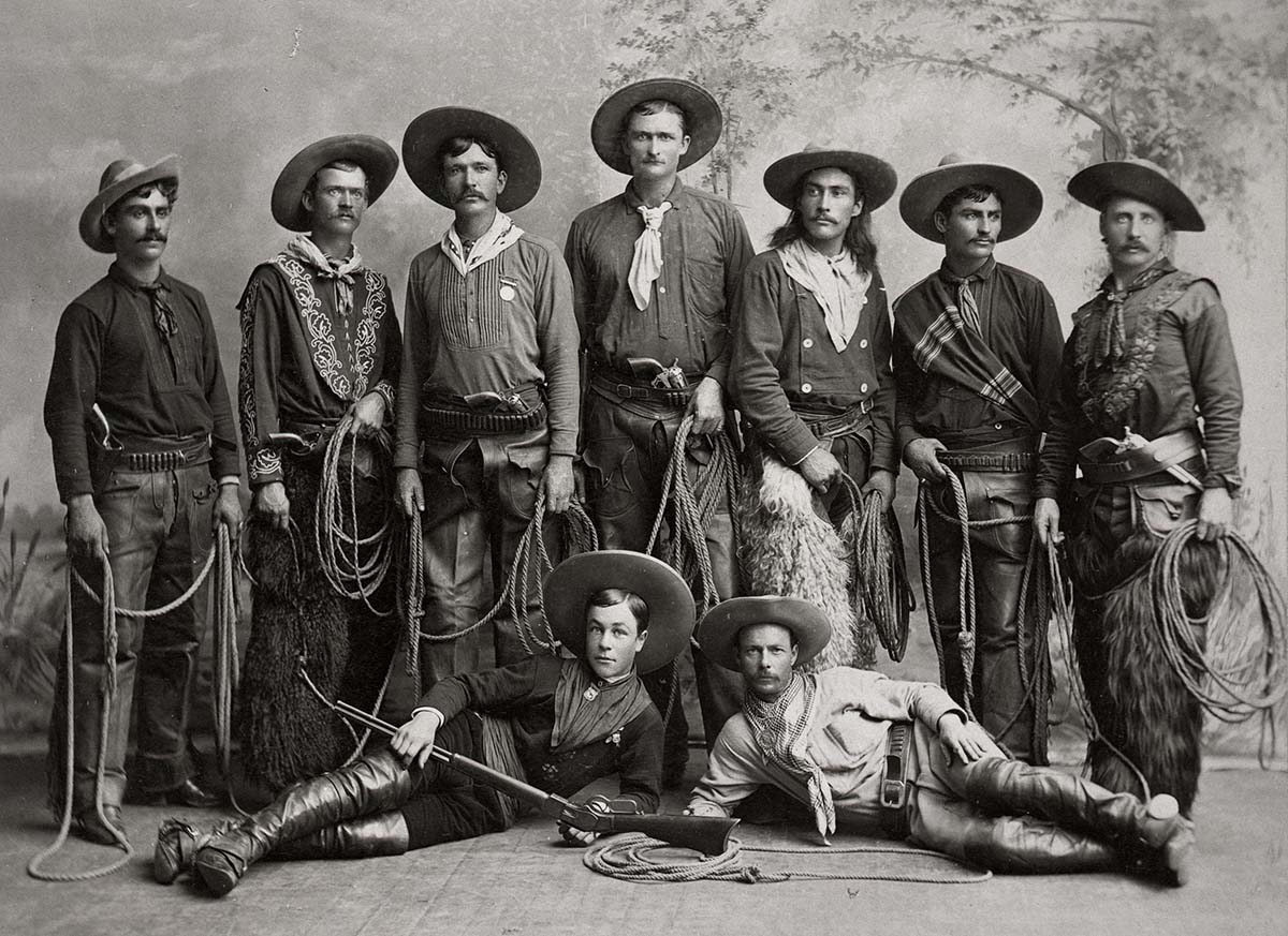 Young cowboys from Buffalo Bill's Wild West, 1886, posing with their guns and chaps. MS 6 William F. Cody Collection. MS 6 William F. Cody Collection, McCracken Research Library. P.6.86