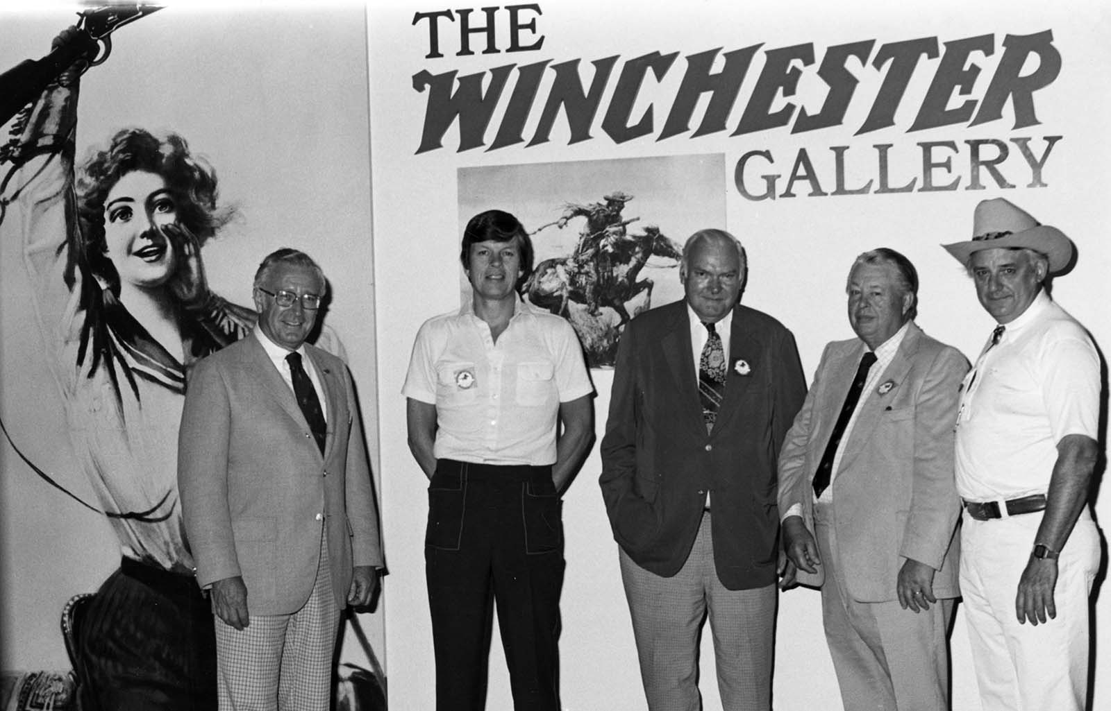 Pictured at the entrance to the Winchester Gallery, July 4, 1976, are (L-R) John Henske, CEO, Olin Corporation; Dick Pelton, Winchester Vice President of Marketing; Phil Richey, Winchester President; William Talley, Center Trustee and retired Winchester executive; and Curt Gowdy, Center Trustee and ABC Sportscaster. P.20.4653