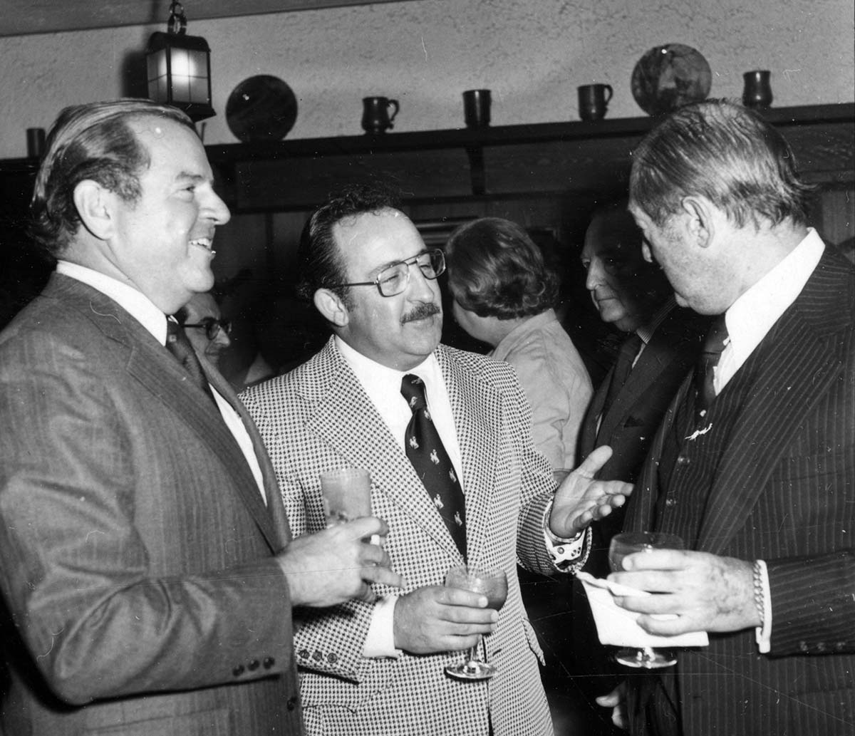 Jim Minter (center) visits with trustee Charles Duncan (left) and 21 Club owner, Peter Kriendler, at the spring 1976 reception with Winchester executives at the 21 Club. PN.20.2683