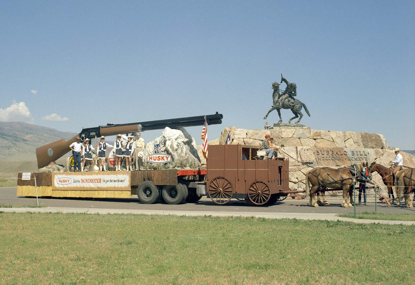 "Husky Oil Company's float celebrating ""Winchester: the gun that won the West,"" July 4, 1968. MS 089 Jack Richard Photograph Collection, McCracken Research Library. PN.89.49.10081.150"