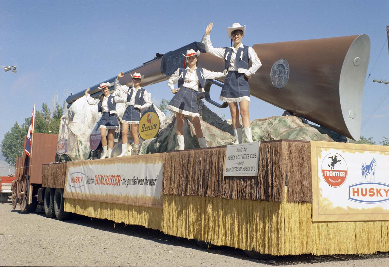 "Husky Oil Company's float celebrating ""Winchester: the gun that won the West,"" July 4, 1968. MS 089 Jack Richard Photograph Collection, McCracken Research Library. PN.89.49.10081.147"