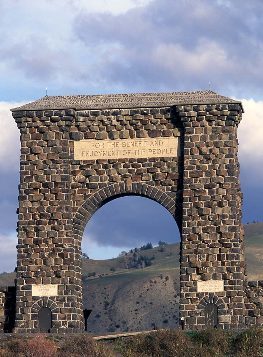 "The Roosevelt Arch at Yellowstone's North Entrance affirms the Park's purpose, ""For the benefit and enjoyment of the people."" National Park Service photo by Jim Peaco, May 2003."