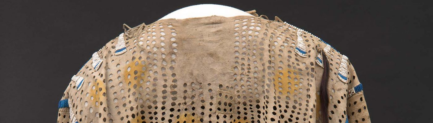Punctured shirt. ca. 1850. The Paul Dyck Plains Indian Buffalo Culture Collection, acquired through the generosity of the Dyck family and additional gifts of the Nielson Family and the Estate of Margaret S. Coe. NA.202.1209