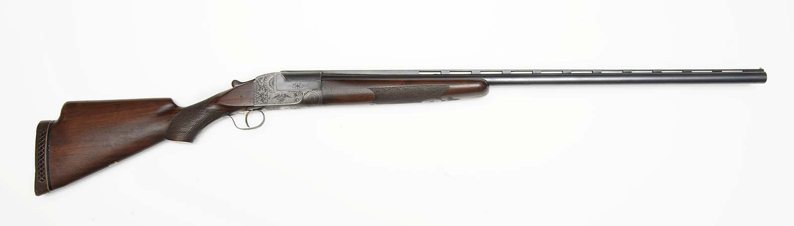Ithaca Single Barrel Trap Gun, 12 gauge, Serial Number 264501, owned by Annie Oakley, stock was changed by a later owner. Gift of Donald Lawson In Honor and Memory of Joseph L. Box. 2008.10.1