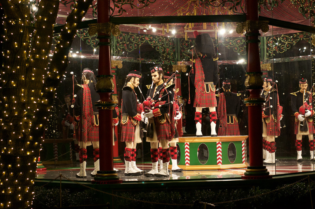 Christmas display representing the pipers in the song 12 Days of Christmas.