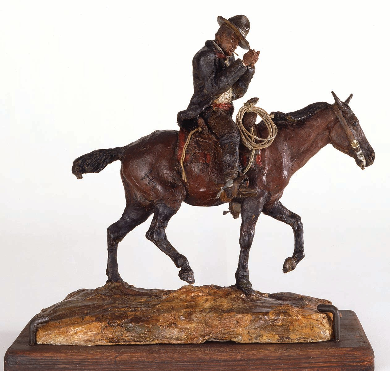 "Fig. 8: ""On Neenah"" (Russell self-portrait), ca. 1897. Painted wax. 9.75 x 4.25 x 9 inches. Gift of Dr. Armand Hammer and Charles Stone Jones. 15.59"