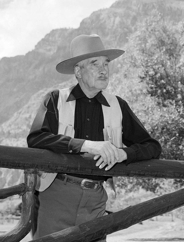 Fig. 9: Larry Larom at his Valley Ranch, located along the South Fork of the Shoshone River southwest of Cody, Wyoming, ca. 1950. MS 089 Jack Richard Photograph Collection, McCracken Research Library. PN.89.116.21416.1 (detail).