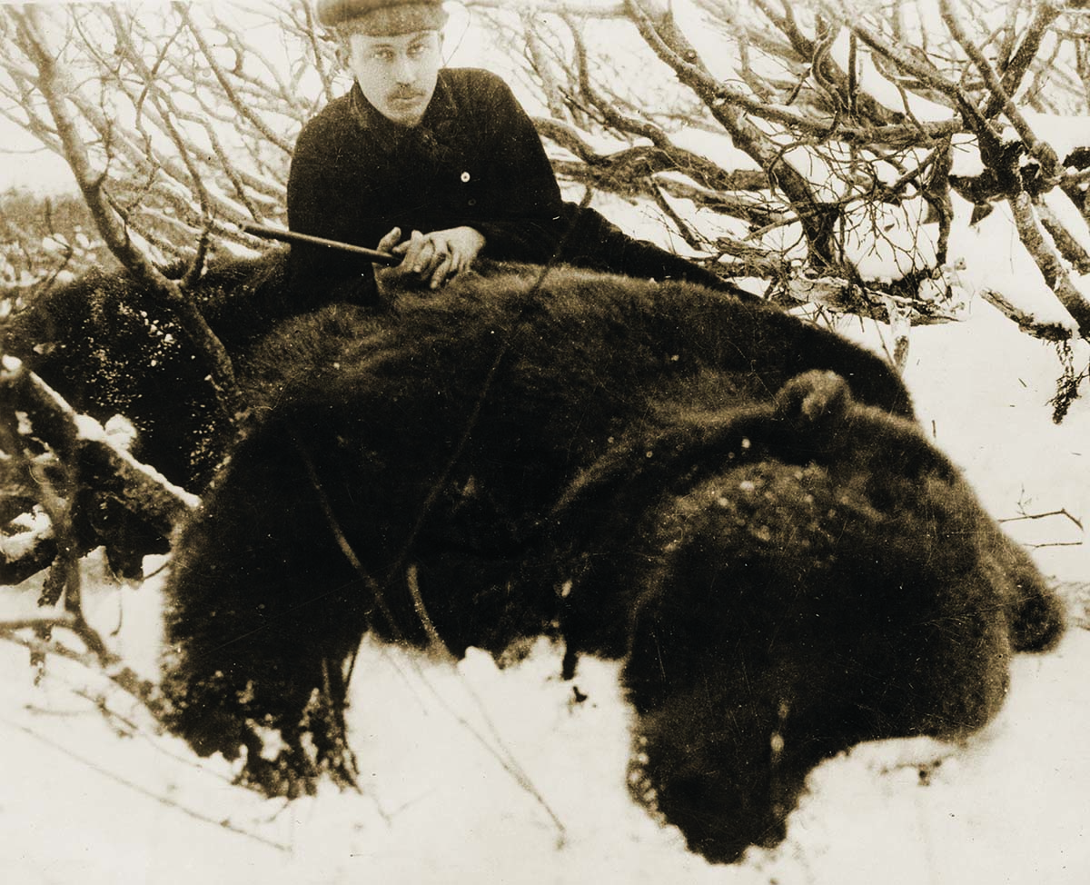 Fig. 6: Harold McCracken with the product of a 1916 hunt, one of the largest Alaskan grizzly bears in recorded hunting history. MS 305 Harold McCracken Photograph Collection, McCracken Research Library. P517