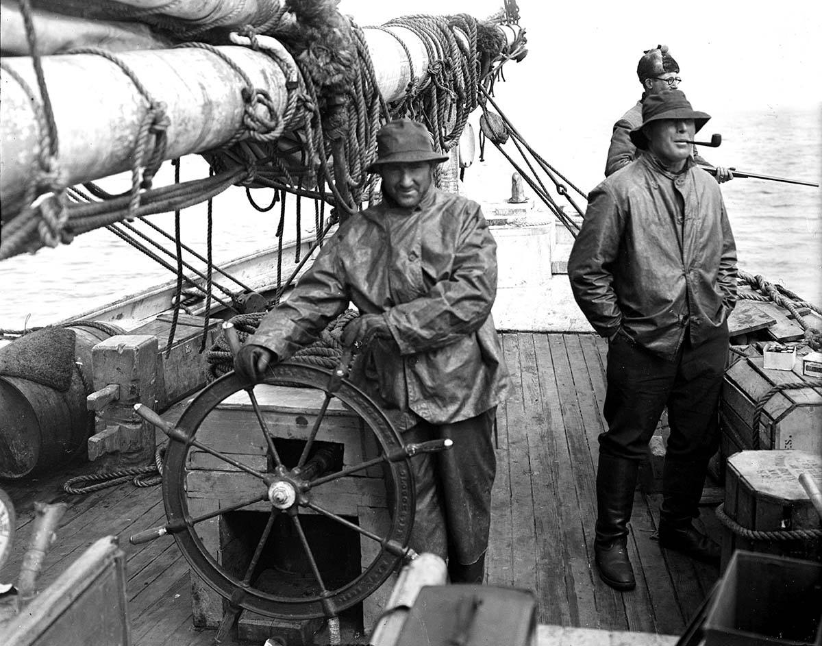 Bartlett (with pipe) on the deck of the Morrissey with McCracken right behind him. MS 305 Harold McCracken Photograph Collection, McCracken Research Library. N282#A1023V