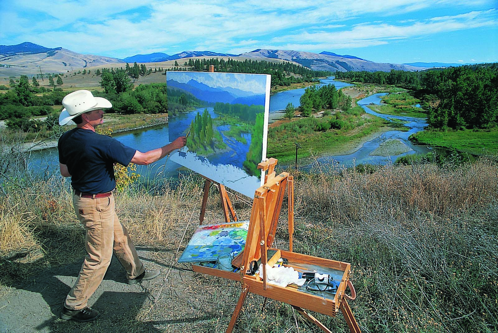 Charles Fritz painting at Traveler's Rest, just west of Lolo, Montana, one of the camping sites of Lewis and Clark and the Corps of Discovery. Photo courtesy Charles Fritz.