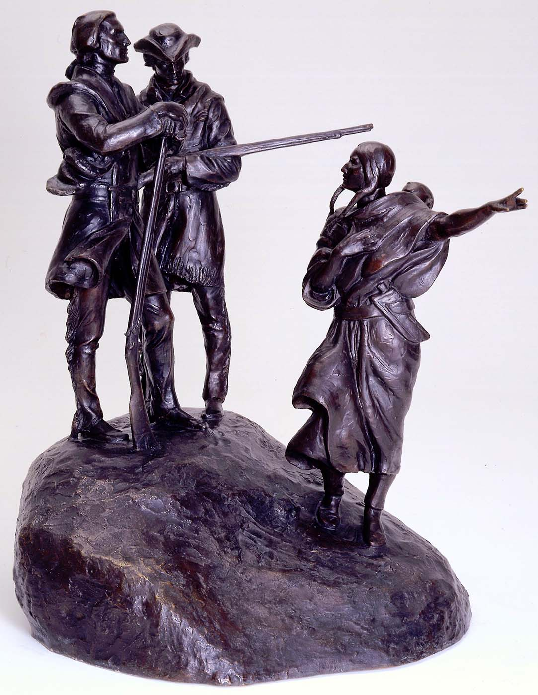 """Henry Lion (1900-1966). """"Lewis and Clark and Sacajawea,"""" ca. 1963. Bronze, 35.25 inches. Gift of Charles S. Jones. 27.64"""