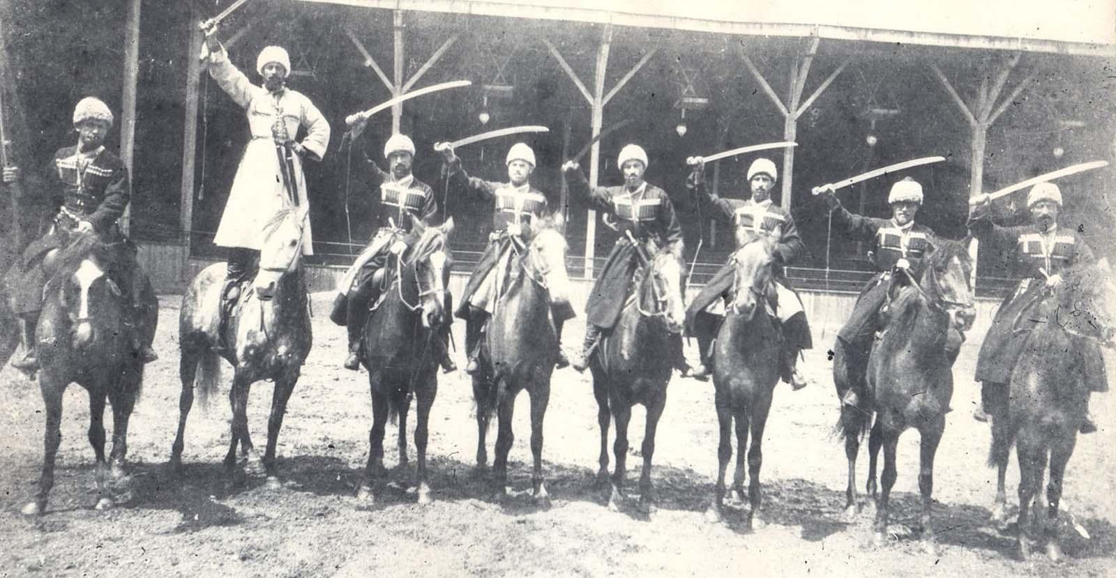Georgian horsemen in England, circa 1903. Standing on the horse, in white chokha, Luka Chkhartishvili. Collection of Irakli Makharadze.