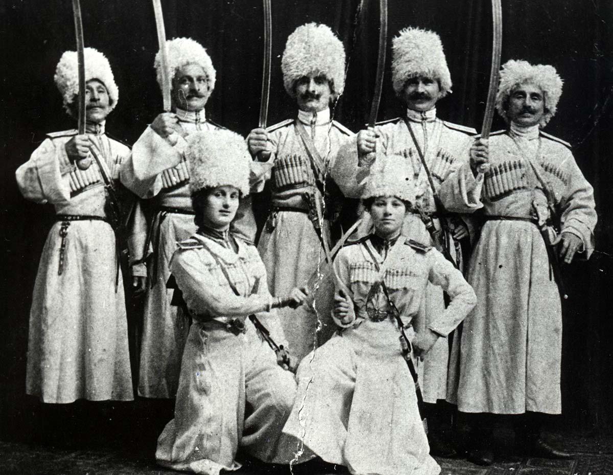 Georgian trick riders, including two women riders in front, ca. 1912. Clockwise from left: Kirile Pirtskhalaishvili, Kitilia Kvitaishvili, Kristephore Imnadze, Veliko Kvitaishvili, Varden Kvitaishvili, Barbale Zakareishvili-Imnadze, Maro Zakareishvili-Kvitaishvili. Collection of Irakli Makharadze.