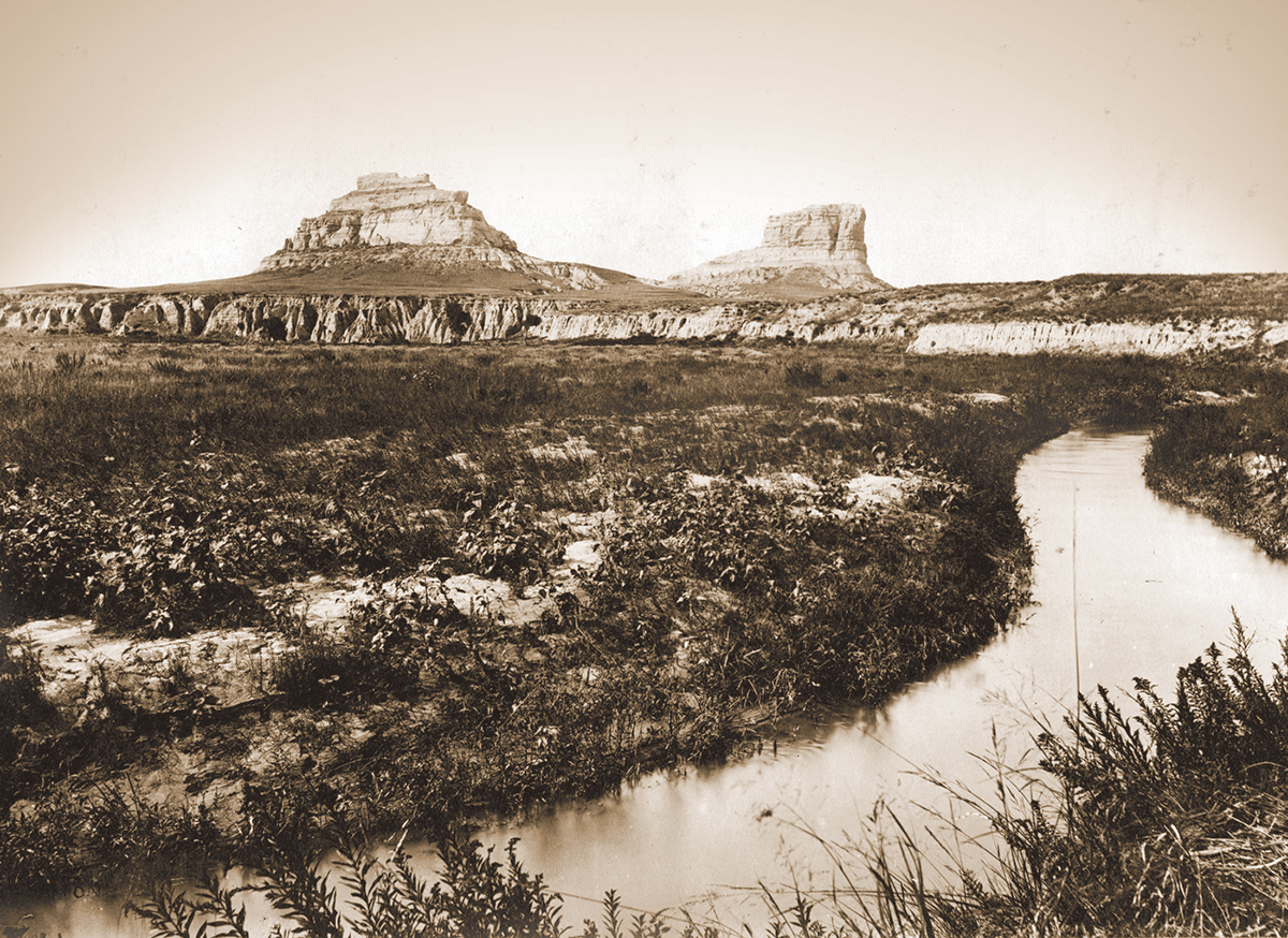 Courthouse and Jail Rocks from the south, Courthouse Rock irrigation canal in the foreground. Cheyenne County, Nebraska, 1897. Plate 4 in U.S. Geological Survey. Professional paper 17. 1903.