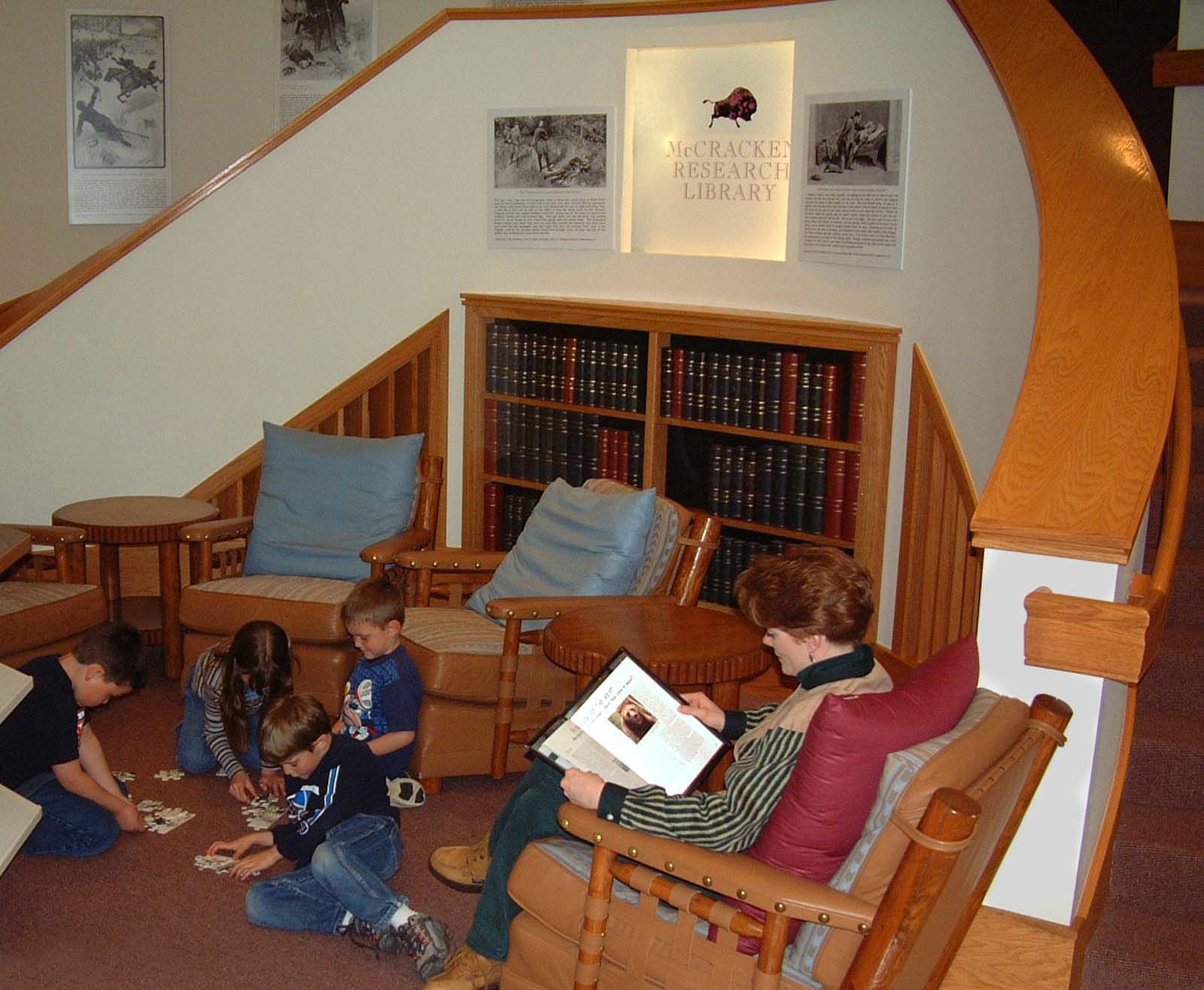 Patrons enjoy a comfortable nook in the Library Gallery outside the Reading Room in 2005.