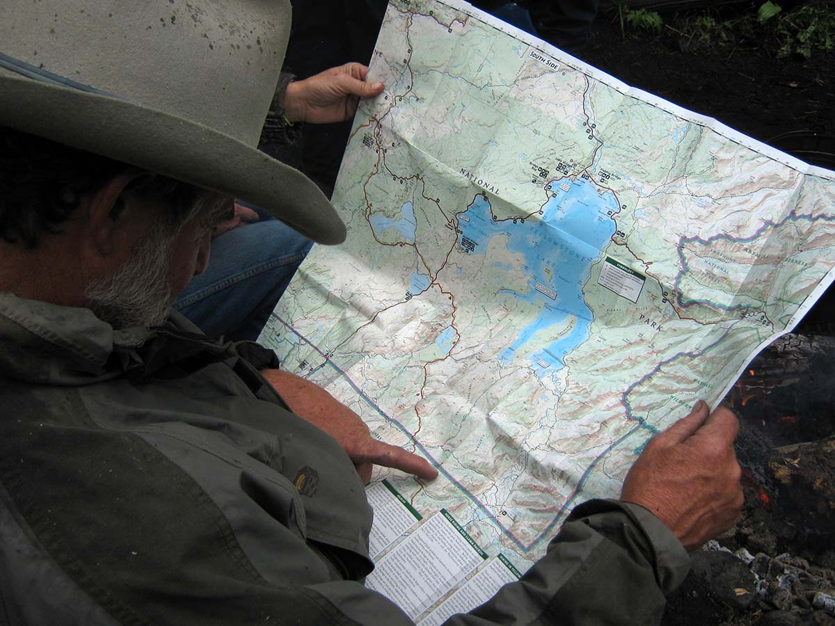 Consulting the map of the Thorofare region of Yellowstone.